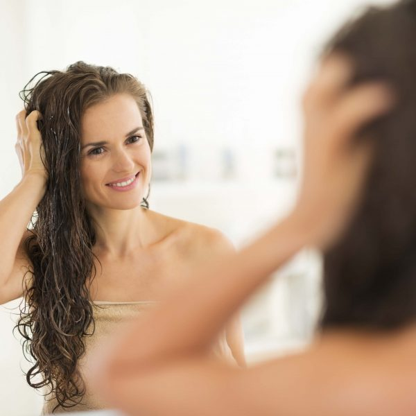 Young woman with wet hair in bathroom